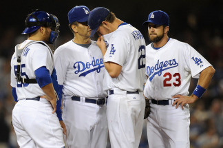Manager Joe Torry, Russell Martin #55, pitcher Clayton Kershaw #22 and Casey Blake #23 have a meeting on the mound during the 2009 MLB Playoffs at Dodger Stadium on October 15, 2009 in Los Angeles, California.