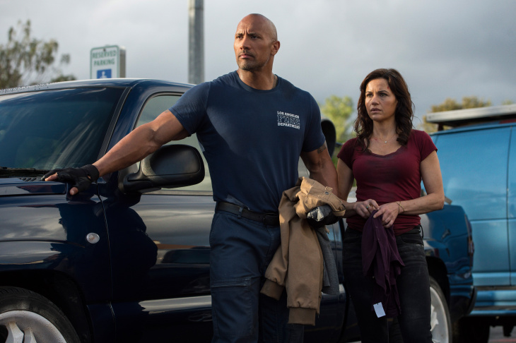 Dwayne Johnson as Ray and Carla Gugino as Emma in the film