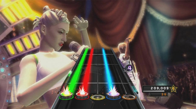 The likenesses of No Doubt perform in the background as a player performs on the guitar during