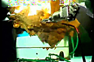 A robotic arm from a submersible works around the leaking Gulf of Mexico wellhead in this still image from a live BP video feed.