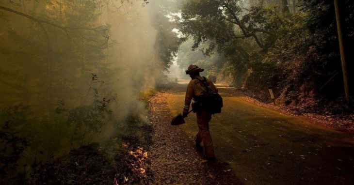In this file photo, Novato Fire District firefighter Kyle Marshall sprays a spot while fighting fires in Big Sur, Calif., Friday, July 29, 2016.