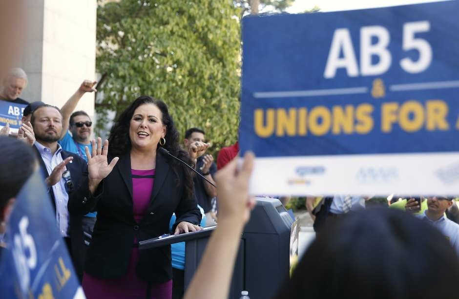 Assemblywoman Lorena Gonzales with organizers for AB5