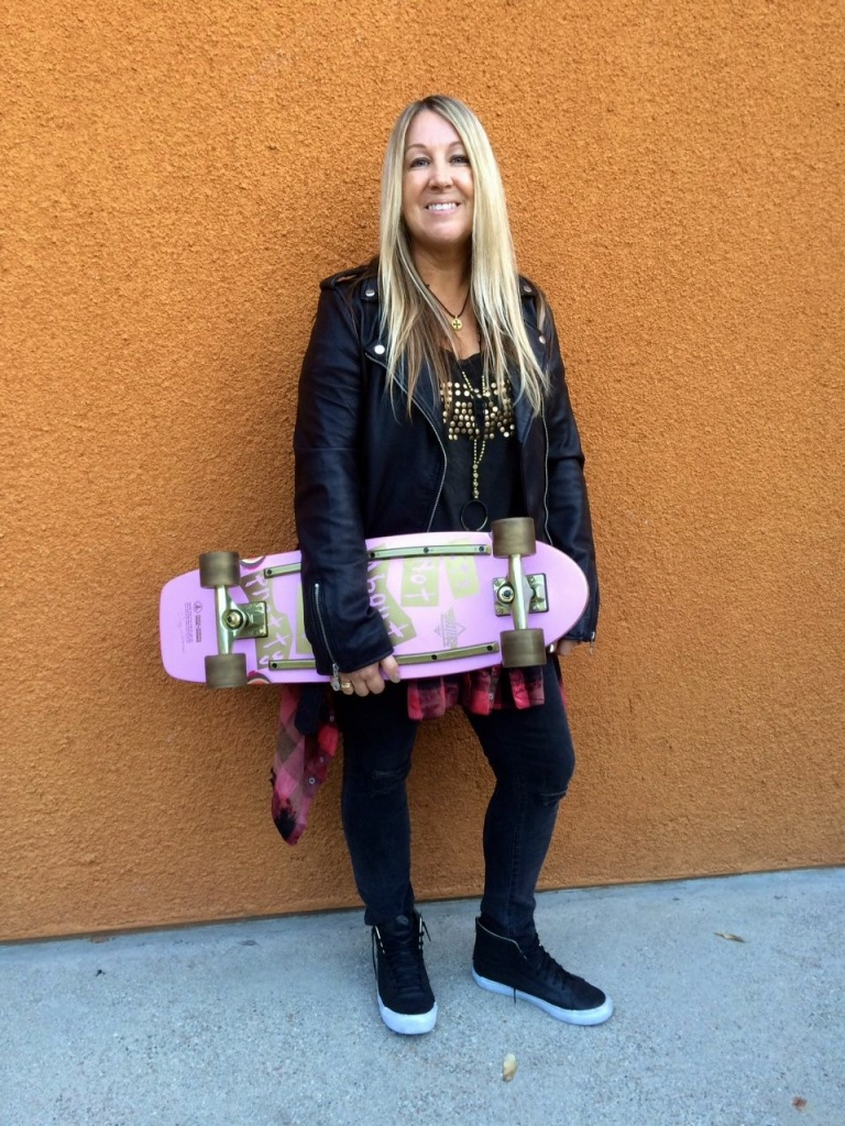 Female skateboarder Cindy Whitehead poses in her Vans at KPCC on Wednesday, March 16, 2016.