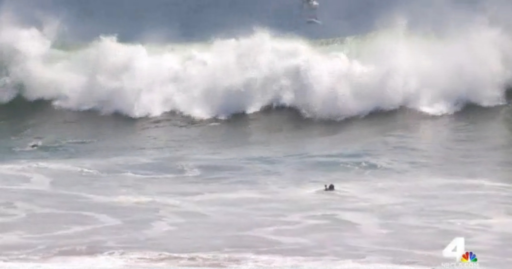 A screenshot from KNBC-TV shows high surf on a Southern California beach.