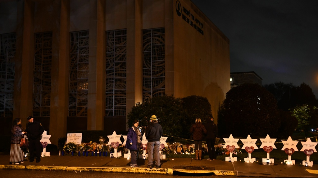 People stand at a memorial for victims of Saturday's shooting at Tree of Life synagogue in Pittsburgh.