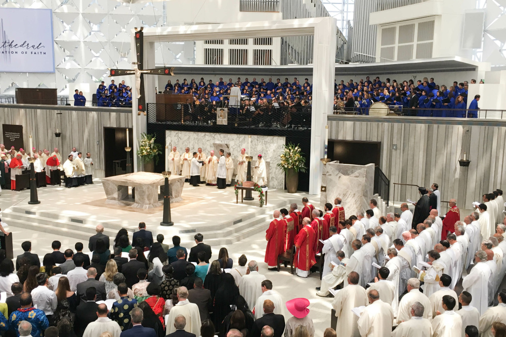 Catholic Bishop Kevin Vann celebrates inaugural mass at the newly renovated Christ Cathedral in Garden Grove.