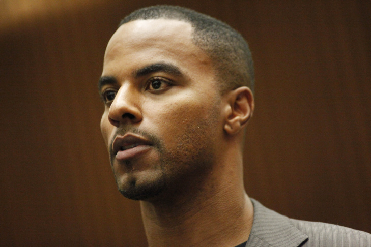 Former NFL player Darren Sharper sits in a Los Angeles courtroom during a bail hearing on March 24, 2014 in Los Angeles, California. Sharper is awaiting trial in Los Angeles after pleading not guilty to charges that he raped and drugged two women last year. He was previously released on $1 million bail before being charged in Arizona with similar counts.