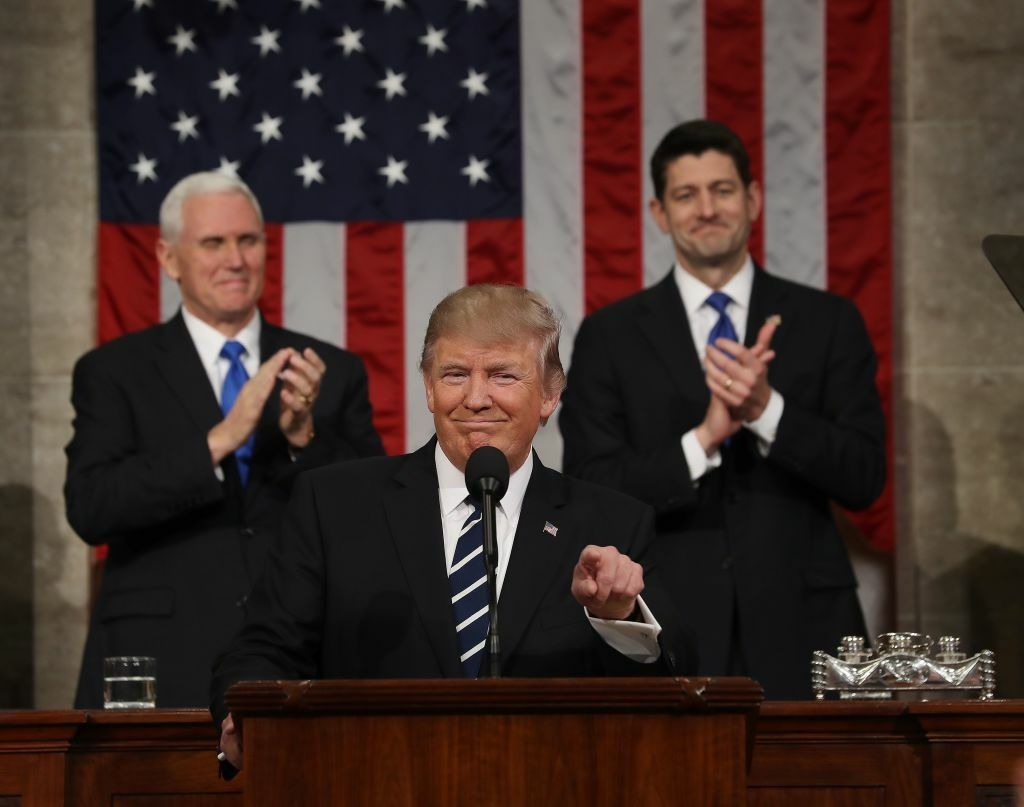 US Vice President Mike Pence (L) and Speaker of the House Paul Ryan (R) applaud as U.S. President Donald J. Trump arrives to deliver his first address to a joint session of Congress from the floor of the House of Representatives in Washington, DC, USA, 28 February 2017.