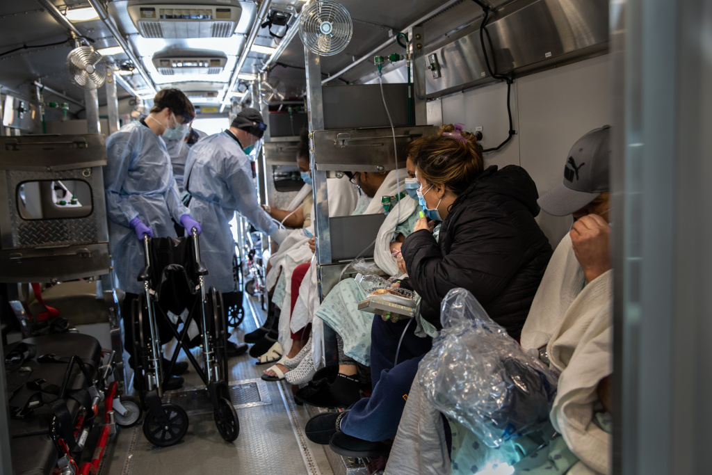 Medics wearing personal protective equipment (PPE), unload COVID-19 patients arriving to the Montefiore Medical Center Moses Campus on April 07, 2020 in the Bronx borough of New York City.