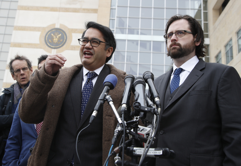 Omar Jadwat of the ACLU, left, accompanied by Justin Cox of the National Immigration Law Center, representing the plaintiffs, speaks to reporters outside court in Greenbelt, Md., Wednesday, March 15, 2017. A federal judge in Maryland says he will issue a ruling in a lawsuit challenging President Donald Trump's revised travel ban. (AP Photo/Manuel Balce Ceneta)