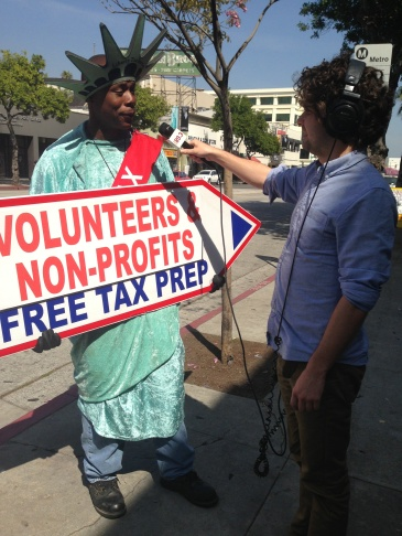 KPCC's Robert Garrova interviewing sign twirler Phillip Tolburt