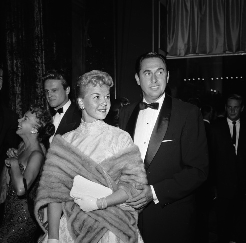 File:  American actress Doris Day with husband Marty Melcher at the film premiere of 'A Star Is Born' featuring Judy Garland on October 13, 1954.  (Photo by Jay Scott/BIPs/Getty Images)