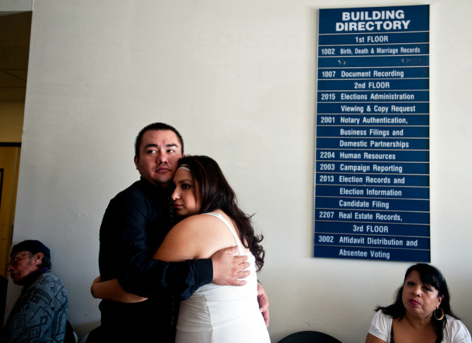 Rick and Jessica Garcia of West Covina kiss after they are married by volunteer  Elizabeth Oakes at the LA County Registrar-Recorder's office on Monday in Norwalk. The couple have been together for two years.