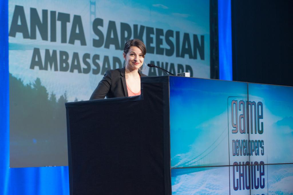 Feminist video game critic Anita Sarkeesian receiving the 2014 Game Developers Choice Ambassador Award.