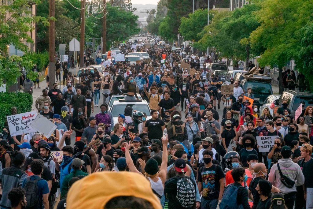 Protesters march through Hollywood after curfew during a demonstration over the death of George Floyd while in Minneapolis Police custody, in Los Angeles, California, June 2, 2020.