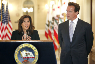 Judge Tani Cantil-Sakauye, left, talks about her nomination as the next Chief Justice of the California Supreme Court as Gov. Arnold Schwarzenegger listens during a ceremony at the Capitol in Sacramento, Calif., on Thursday, July 22, 2010.