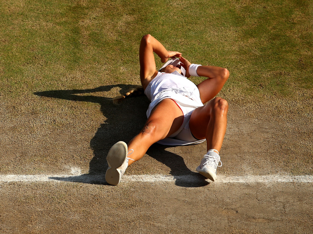 Angelique Kerber fell to the ground in disbelief after match point, celebrating her Wimbledon victory over seven-time tournament champion Serena Williams.