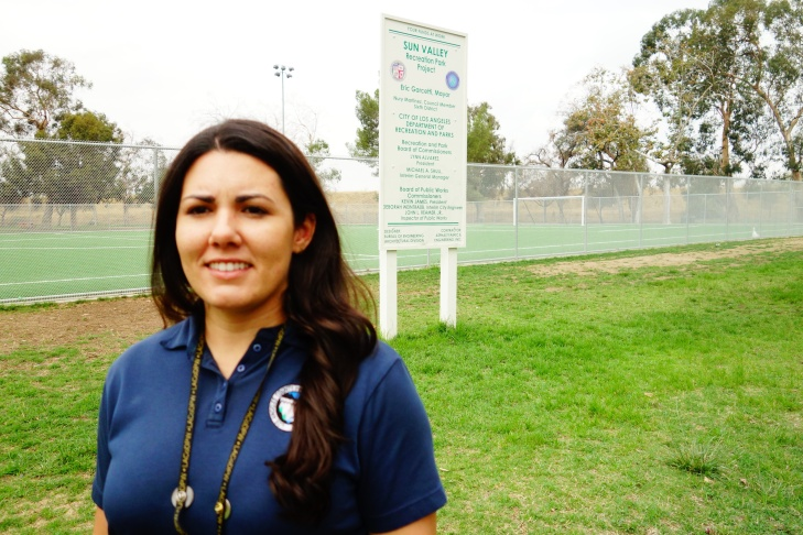 Christine Wartman, an associate civil engineer with Los Angeles County Flood Control, at a soccer field at Sun Valley Park. The soccer field sits atop underground caverns used to drain stormwater into the earth.