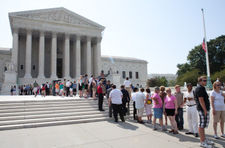 People wait in line to enter the U.S. Supreme Court before the announcement of a ruling in a case seeking to overturn Chicago's ban on handguns on June 28, 2010 in Washington, DC. The court overturned the ban, a victory for gun rights groups.