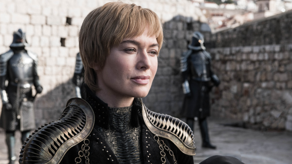 Queen Cersei (Lena Headey) smiling that smile of hers on <em>Game of Thrones.</em> Shoulder pads courtesy Julia Sugarbaker.