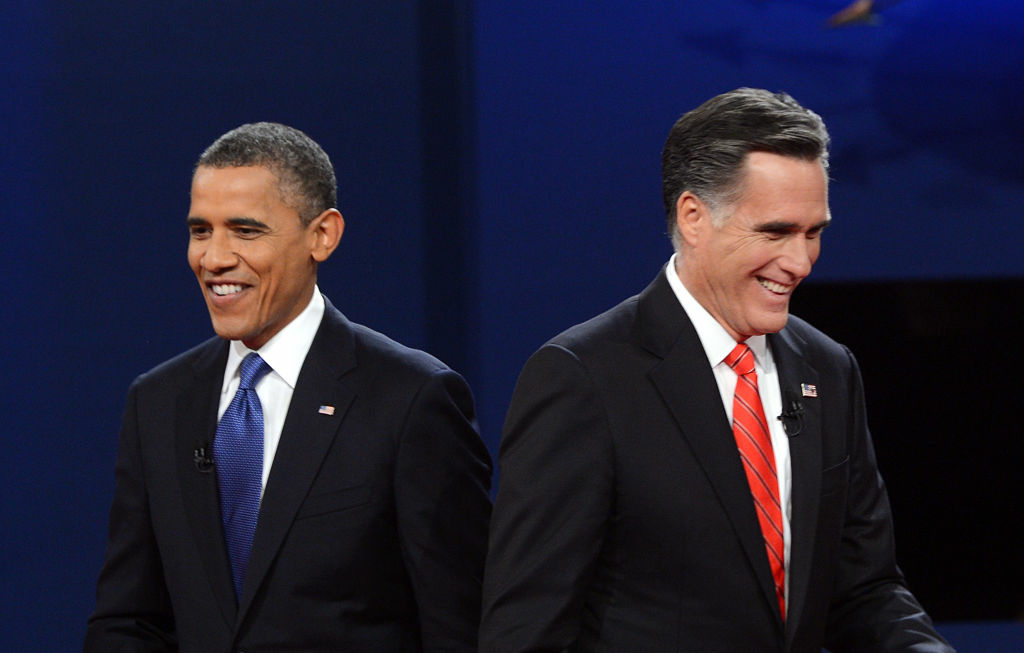 US President Barack Obama (L) and Republican presidential candidate Mitt Romney finish their debate at the University of Denver in Denver, Colorado, October 3, 2012. After hundreds of campaign stops, $500 million in mostly negative ads and countless tit-for-tat attacks, Obama and Romney go head-to-head in their debut debate.