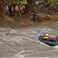 Los Angeles Fire Department's Swift Water Rescue personnel search for a possible deceased individual on an island in the middle of the LA River near the Atwater Village neighbourhood during a rain storm in Los Angeles, California on January 12, 2017.   A series of storms that have rolled across California in the past week dumping heavy rain and snow could herald the end of a punishing historic drought, officials said. / AFP / Konrad Fiedler        (Photo credit should read KONRAD FIEDLER/AFP/Getty Images)