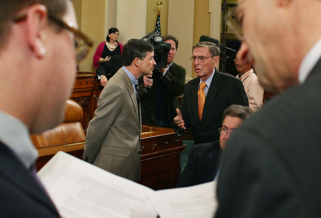 Former Sen. Pete Domenici (R-NM)(R), talks with Rep. Jeb Hensarling (R-TX)(L), during a Joint Deficit Reduction Committee hearing on Capitol Hill, on Nov. 1, 2011, in Washington, DC. The special Joint Committee is tasked with finding $1.2 trillion in deficit reduction by Thanksgiving.
