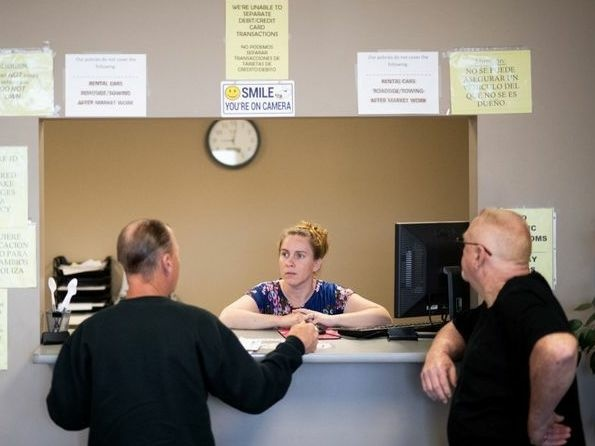 Clarisa Corber at work at a Topeka, Kan., insurance agency. Corber and her husband — who have three kids, a health plan and $15,000 in medical debt — were profiled in a recent <em>Los Angeles Times</em> <a href=