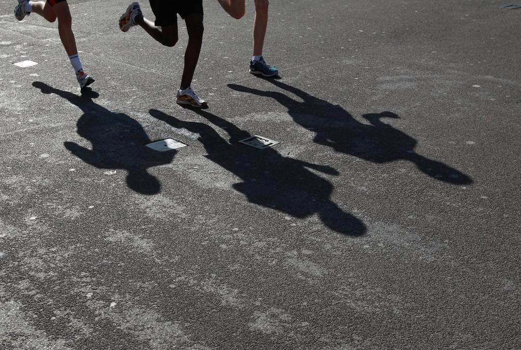 Runners pass Westminster during the Virgin London Marathon 2012 London, England.