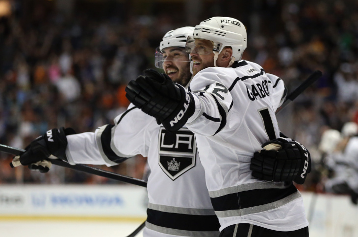 Drew Doughty (L) #8 and Marian Gaborik #12 of the Los Angeles Kings celebrate Gaborik's second period goal against the Anaheim Ducks in Game Seven of the Second Round of the 2014 NHL Stanley Cup Playoffs at Honda Center on May 16, 2014 in Anaheim.