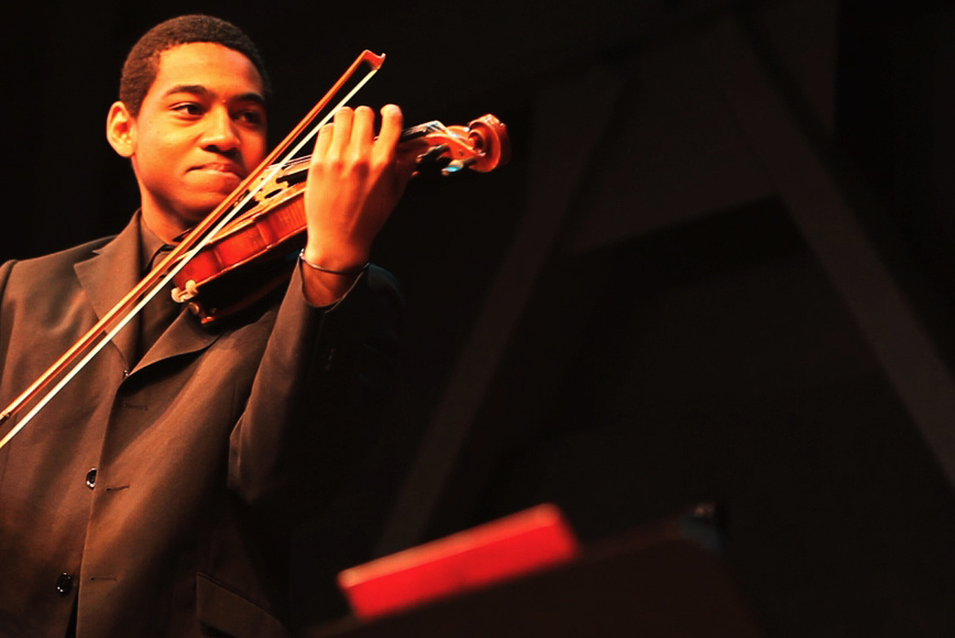 Victor Ekpo, 16, keeps time with a virtuoso.