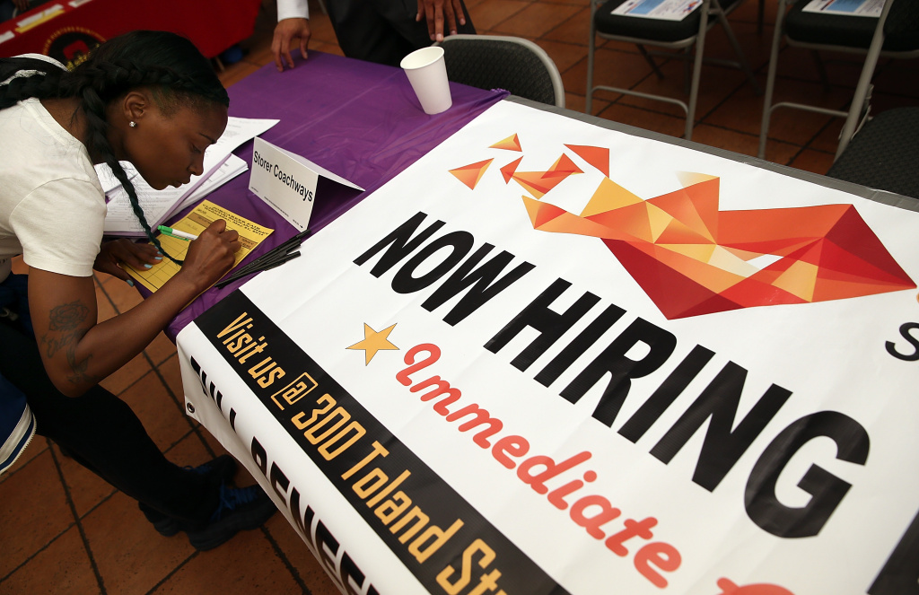 A job seeker fills out an application during a career fair at the Southeast Community Facility Commission on May 21, 2014 in San Francisco