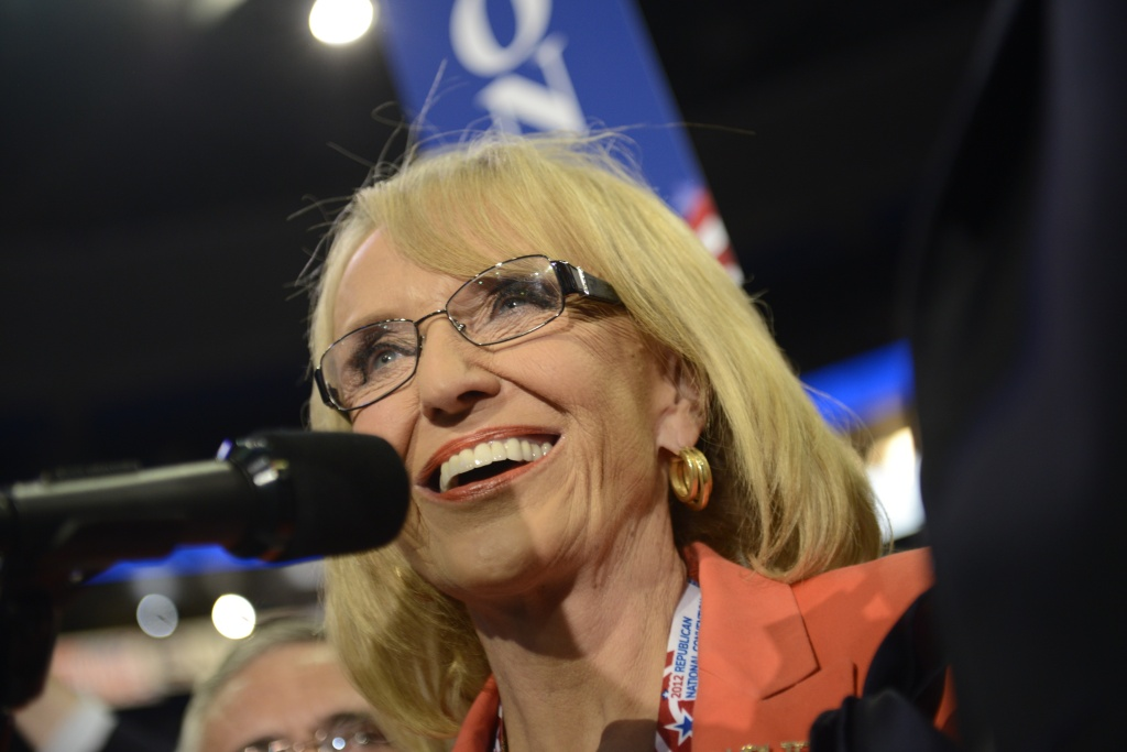 : Governor from Arizona (L) Jan Brewer speaks on the microphone during roll call for nomination of president of the United States at the Tampa Bay Times Forum in Tampa, Florida, on August 28, 2012 during the Republican National Convention.