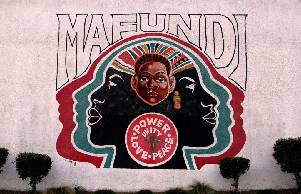 The Mafundi Institute mural on 103rd street in Watts. The historic building, long a hub of local arts and activism, is now home to the Mafundi auditorium and the Watts Coffee House and restaurant.