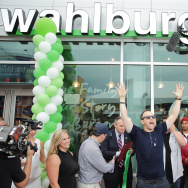 Donnie Wahlberg, Paul Wahlberg, City councilman Mark Treyger and Brooklyn Chamber President Carlo Scissura cut the ribbon to the new Wahlburgers Coney Island resturant on June 23, 2015 in the Brooklyn Borough of New York City.