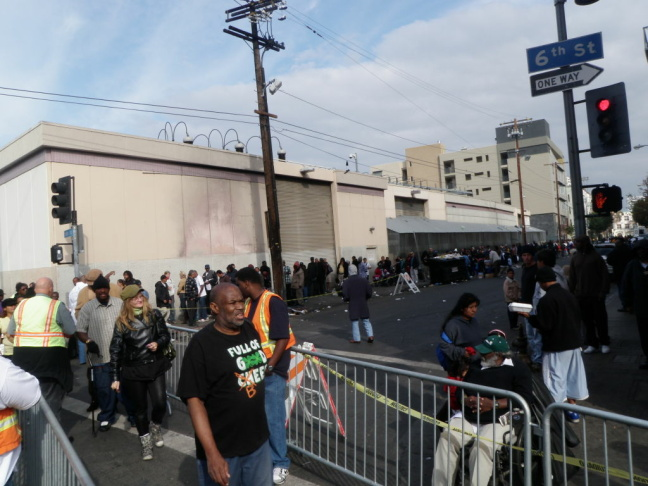 About 350 volunteers helped pass out holiday meals to the homeless on Thanksgiving at the Los Angeles Midnight Mission on Skid Road.