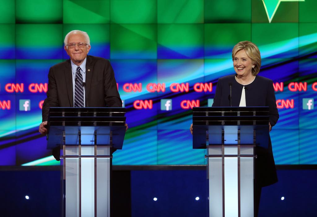 Democratic presidential candidates Sen. Bernie Sanders (I-VT) (L) and Hillary Clinton take part in a presidential debate sponsored by CNN and Facebook at Wynn Las Vegas.