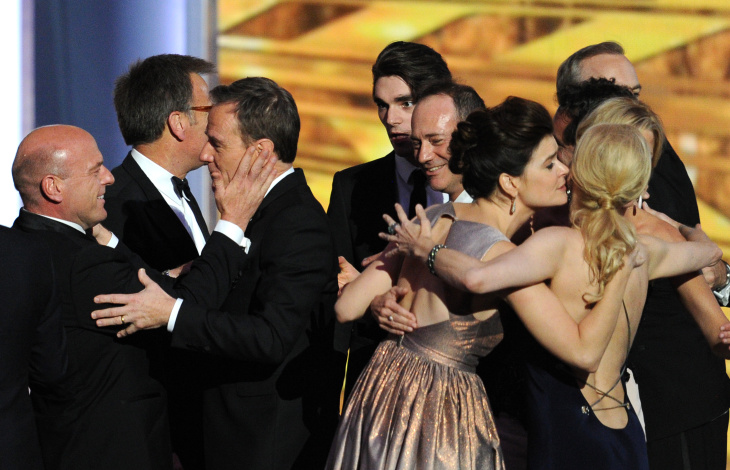 (L-R) Actor Dean Norris, actor Bryan Cranston, actor RJ Mitte, guest, actress Betsy Brandt and fellow cast and crew of 'Breaking Bad' appear onstage during the 65th Annual Primetime Emmy Awards held at Nokia Theatre L.A. Live on September 22, 2013 in Los Angeles, California.