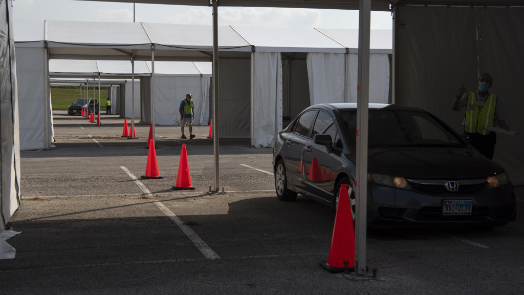 Voters drop off mail-in ballots last month at a drive-through polling place in Houston. Some 127,000 voters cast their ballots at drive-through locations in the Houston area.