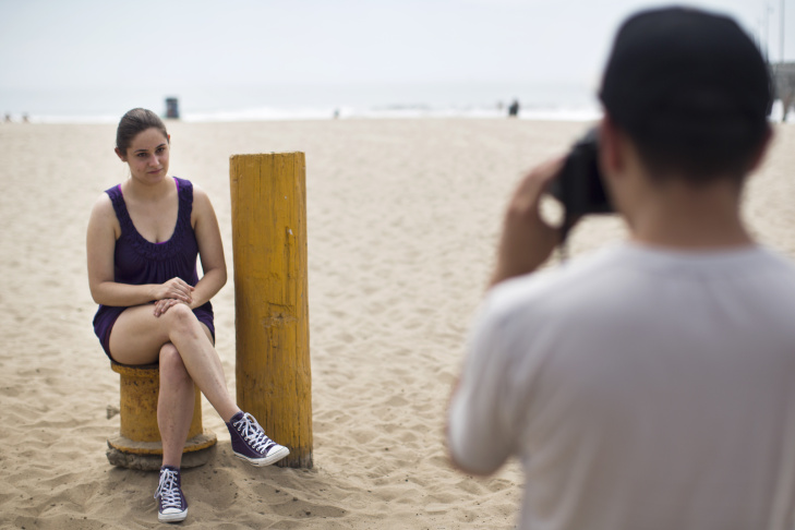 Photographer Richard Renaldi leads a photo walk with students from Loyola Marymount University at the Venice Beach Pier on Thursday afternoon, Sept. 10, 2015. Renaldi just released a book for his series,