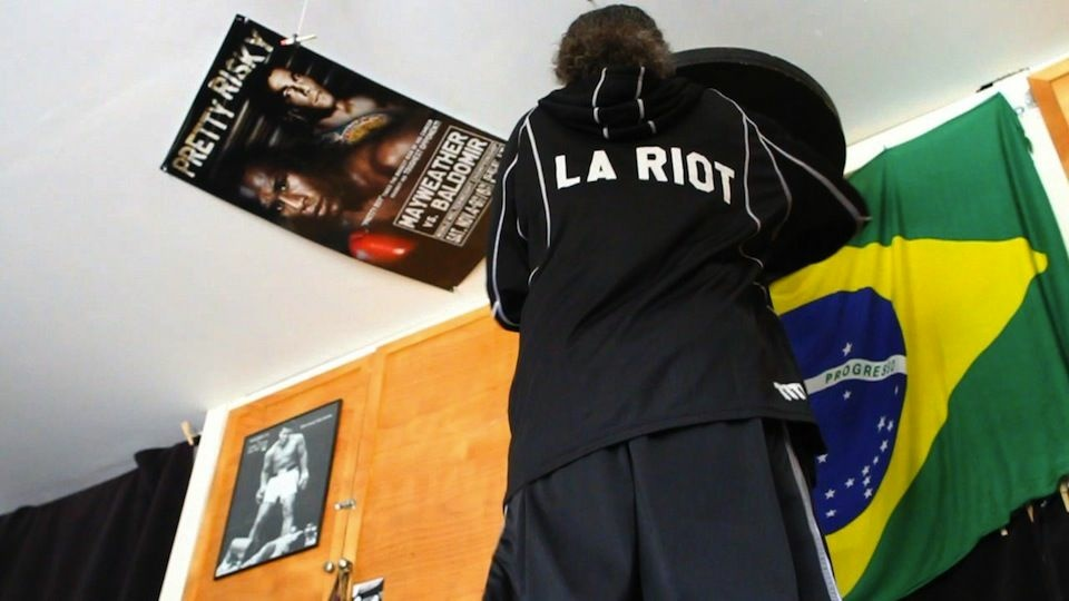 Most Angelenos would like to forget the '92 riots.  Lloyd Wilkey has embraced them. The boxer and community activist calls himself The LA Riot.