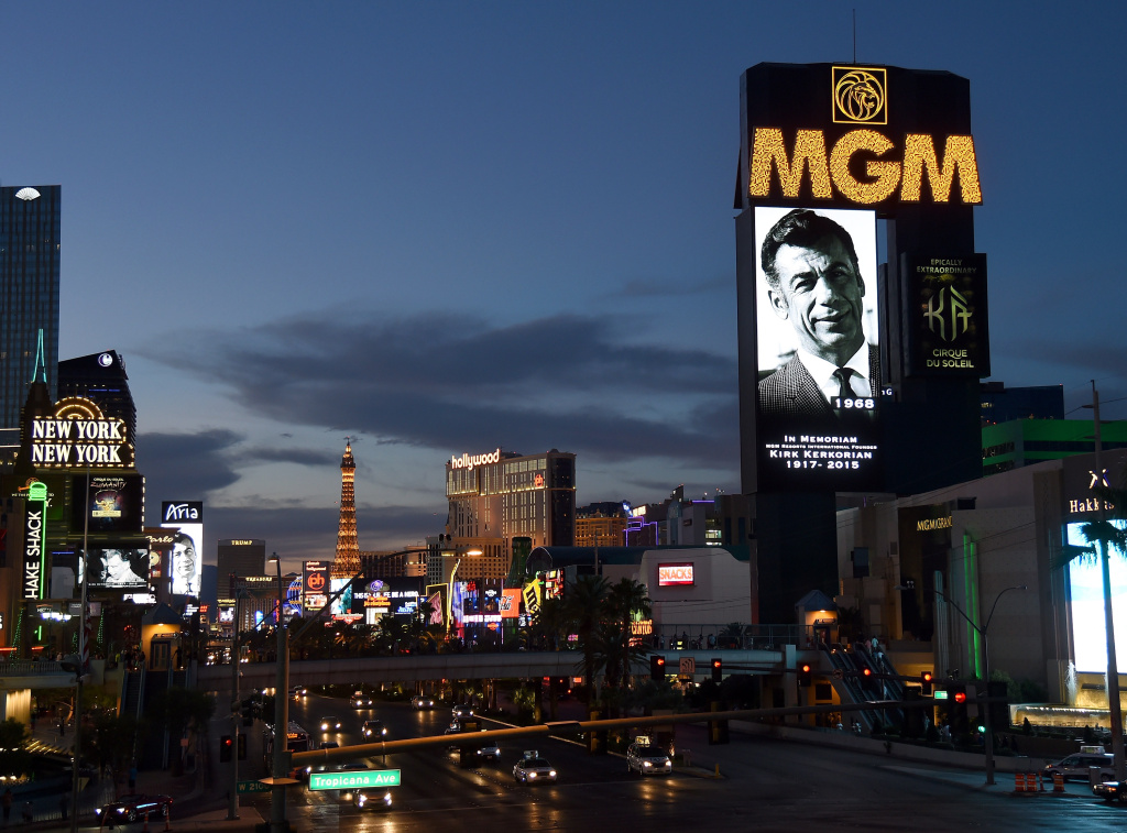 Marquees on the Las Vegas Strip, including at MGM Grand Hotel & Casino (R), show video tributes to billionaire investor Kirk Kerkorian on June 16, 2015 in Las Vegas, Nevada.