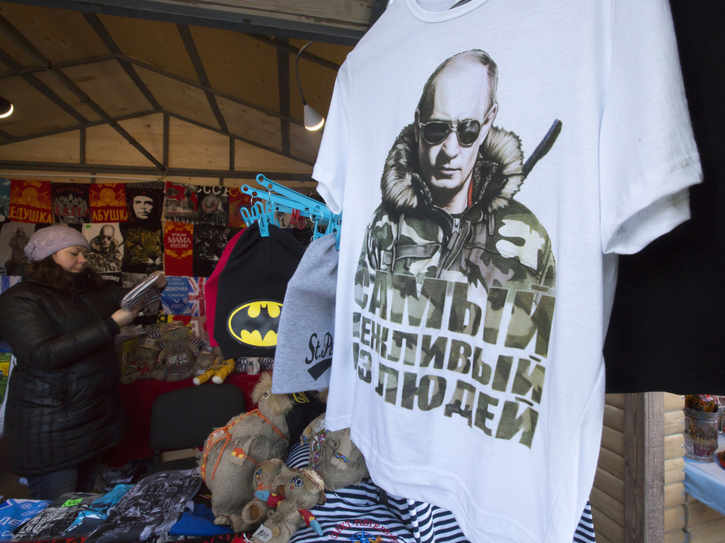 A T-shirt bearing the image of Russian President Vladimir Putin reads