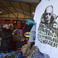 "A T-shirt bearing the image of Russian President Vladimir Putin reads ""The most polite man"" at a St. Petersburg market in Russia on Wednesday. Putin began the year in dramatic fashion by hosting the Winter Olympics and seizing the Crimea. However, his year ended with Russia's economy in turmoil and forecasts of a recession for 2015."