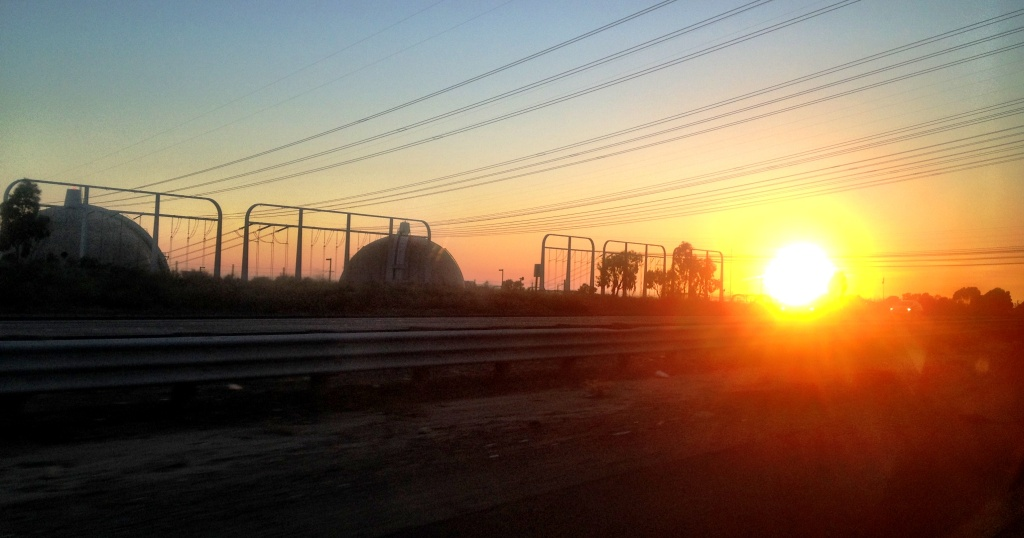 Federal number crunchers said the shutdown of the San Onofre nuclear plant is partially to blame for a 59 percent increase in wholesale electricity prices for California. (Photo:The sun sets behind the San Onofre Nuclear Generating Station in northern San Diego County).
