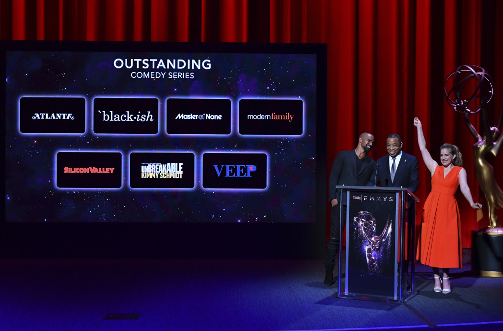 Shemar Moore, from left, Television Academy Chairman and CEO, Hayma Washington, and Anna Chlumsky announce the nominees for outstanding comedy series at the 69th Emmy Nominations Announcement at the Television Academy's Wolf Theatre at the Saban Media Center on Thursday, July 13, 2017, in the NoHo Arts District in Los Angeles. (Photo by Vince Bucci/Invision for The Television Academy/AP Images)