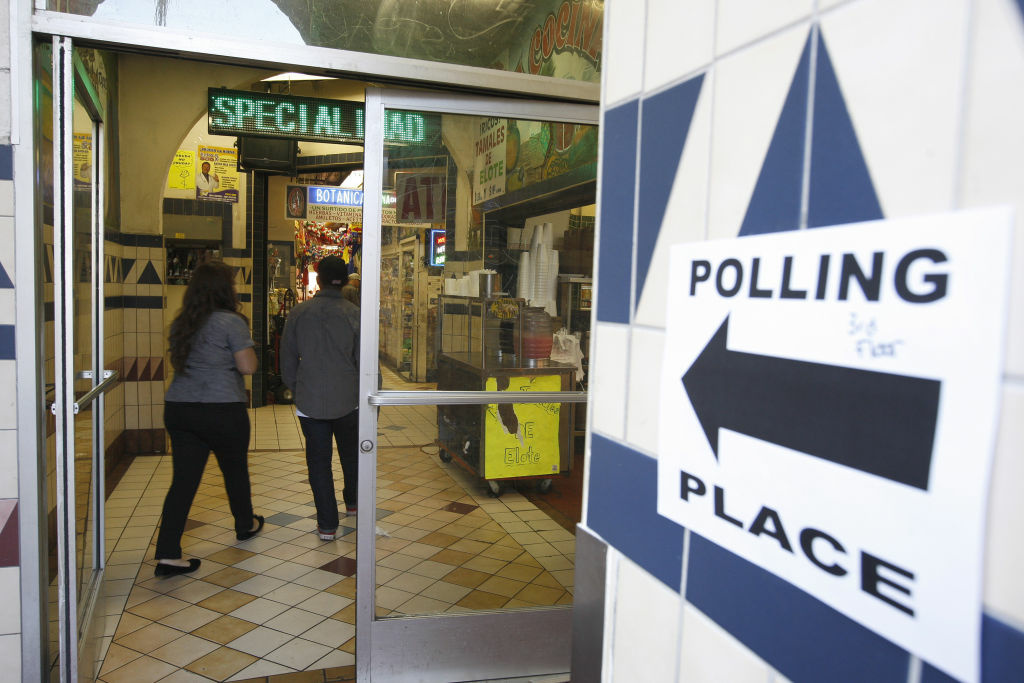 A directional sign points the way to a polling place inside El Mercado de Los Angeles, a Mexico-style marketplace in East L.A. on November 6, 2012.