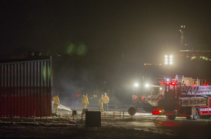 Firefighters work to extinguish fire at the site of a plane crash in Santa Monica, Calif., on Sunday, Sept. 29, 2013. Authorities say a twin-jet Cessna Citation went off the right side of the runway and crashed into a hangar after landing about 6:20 p.m. Authorities called it an