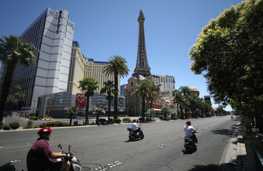 People on scooters ride on the quiet Las Vegas Strip, where most businesses have been closed since March 17 in response to the coronavirus (COVID-19) pandemic, on May 24, 2020 in Las Vegas, Nevada.