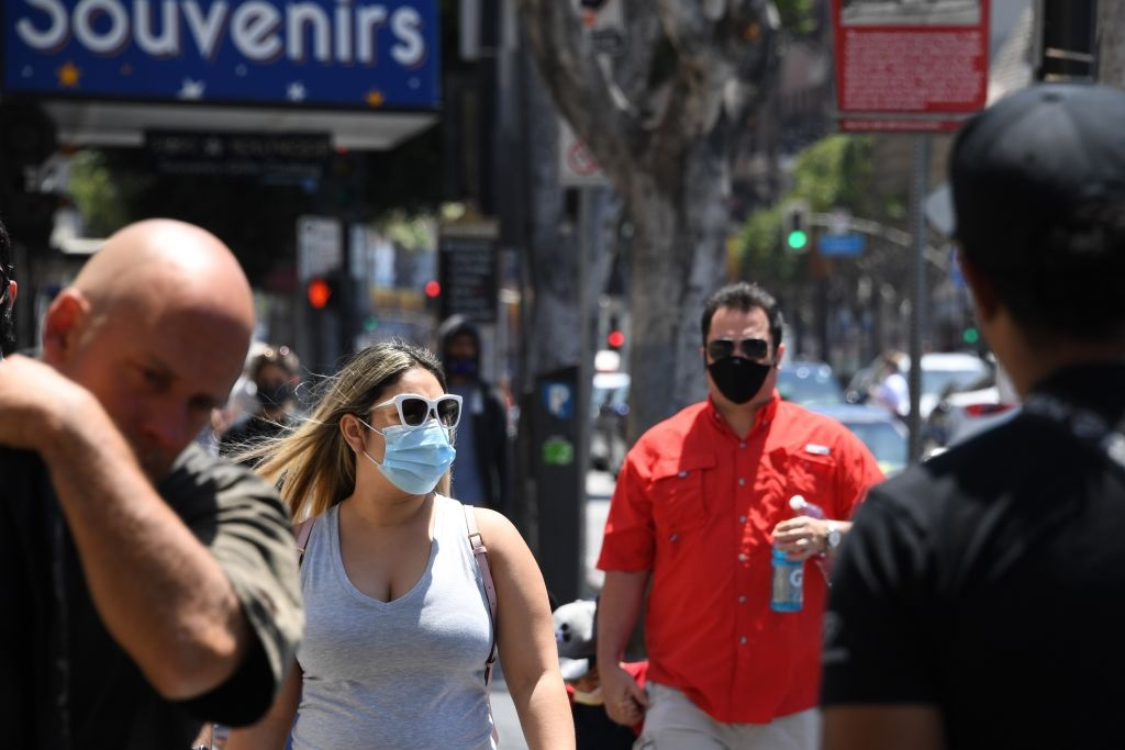 People wearing masks visit the Hollywood Walk of Fame in Hollywood, California June 30, 2020.